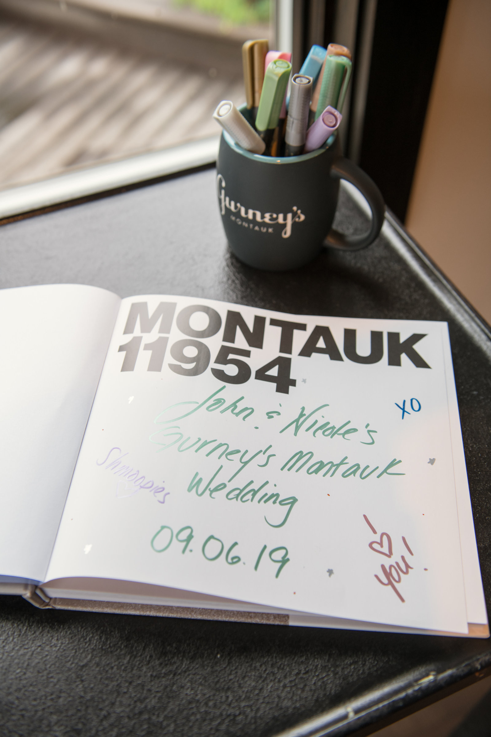 photo of guest book from Gurneys Montauk Resort wedding