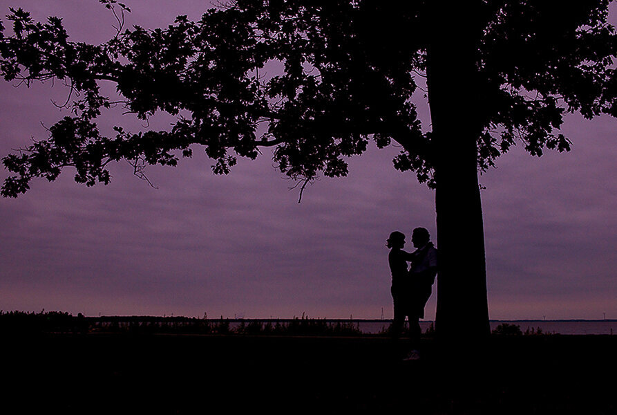 Silhouette of engaged couple at Battery Park Delaware