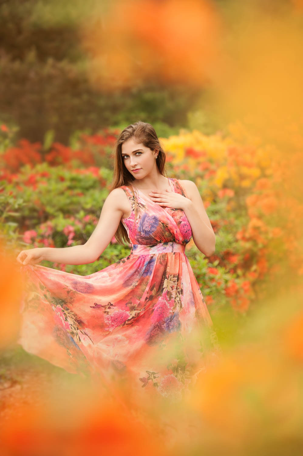 Technicolor senior picture outdoors in floral garden