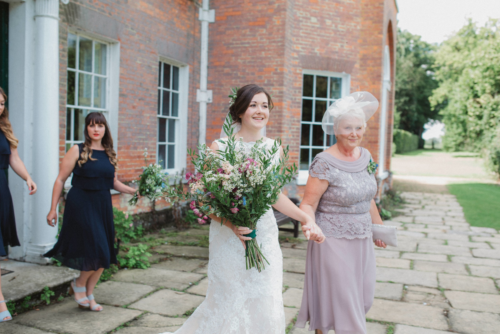 Elegant bride with her mother walking to her ceremony at St Pauls, Waldenbury wedding ceremony