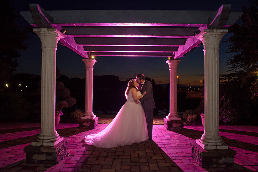 Night photo of bride and groom at Hilton Christiana