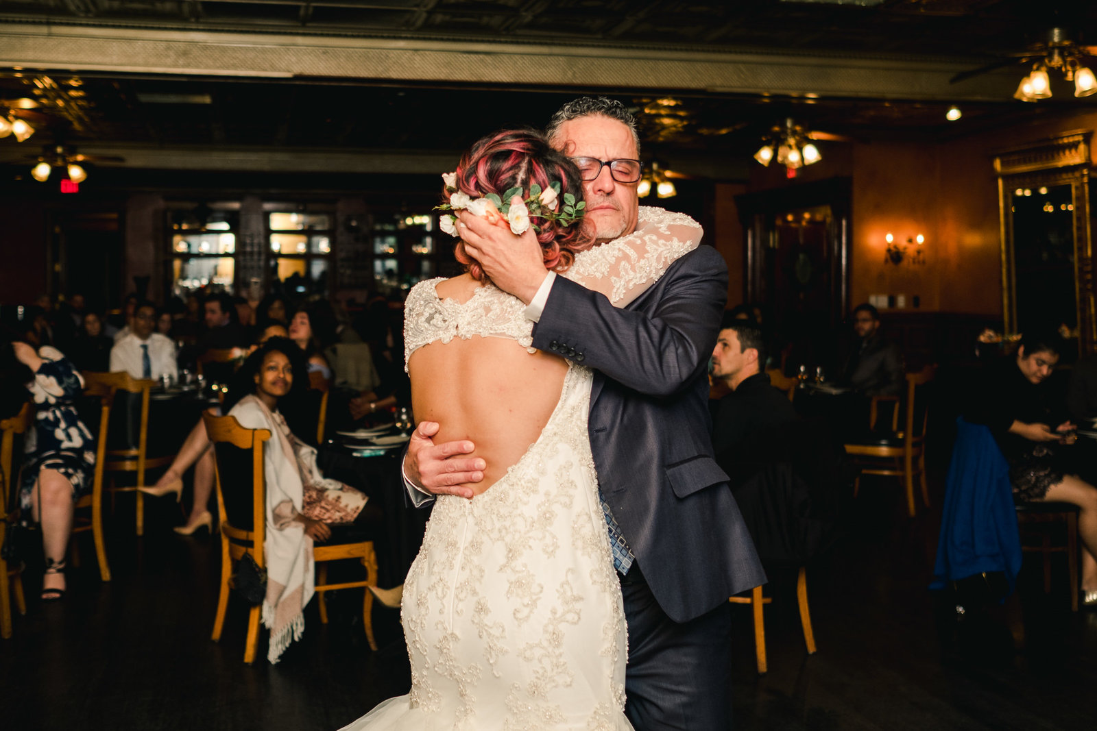 Father of the Bride emotionally embraces bride during the father daughter dance