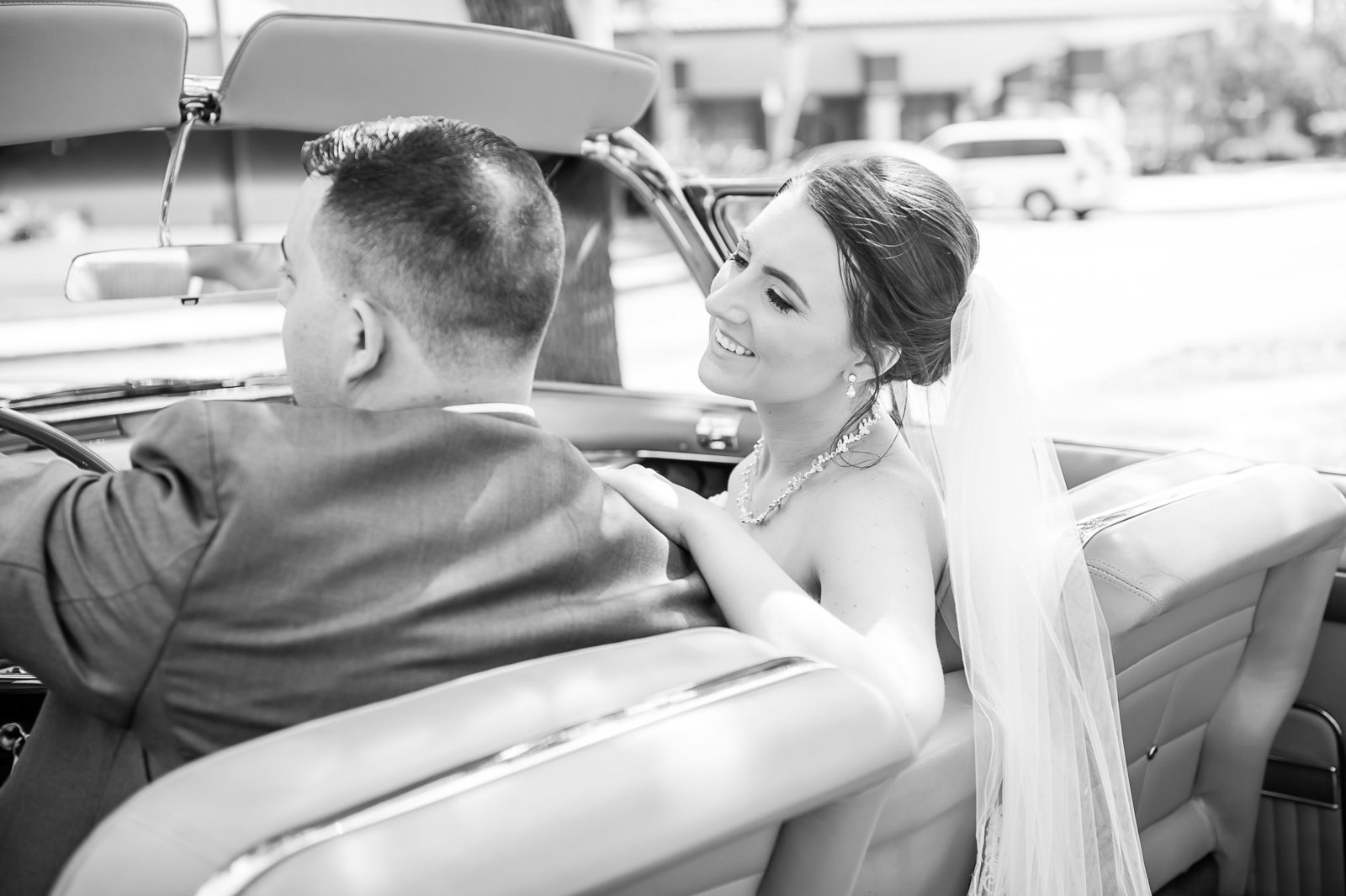 Newlywed Driving - Country Club at Mirasol Wedding - Palm Beach Wedding Photography by Palm Beach Photography, Inc.