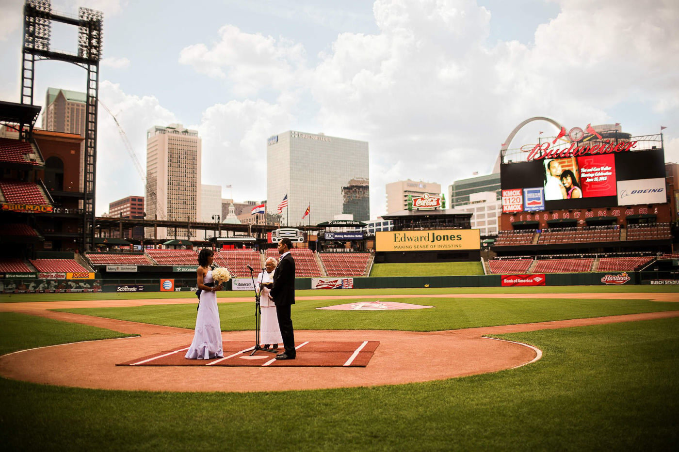 wedding couple married on home base of baseball field St Louis Pinxit Photo