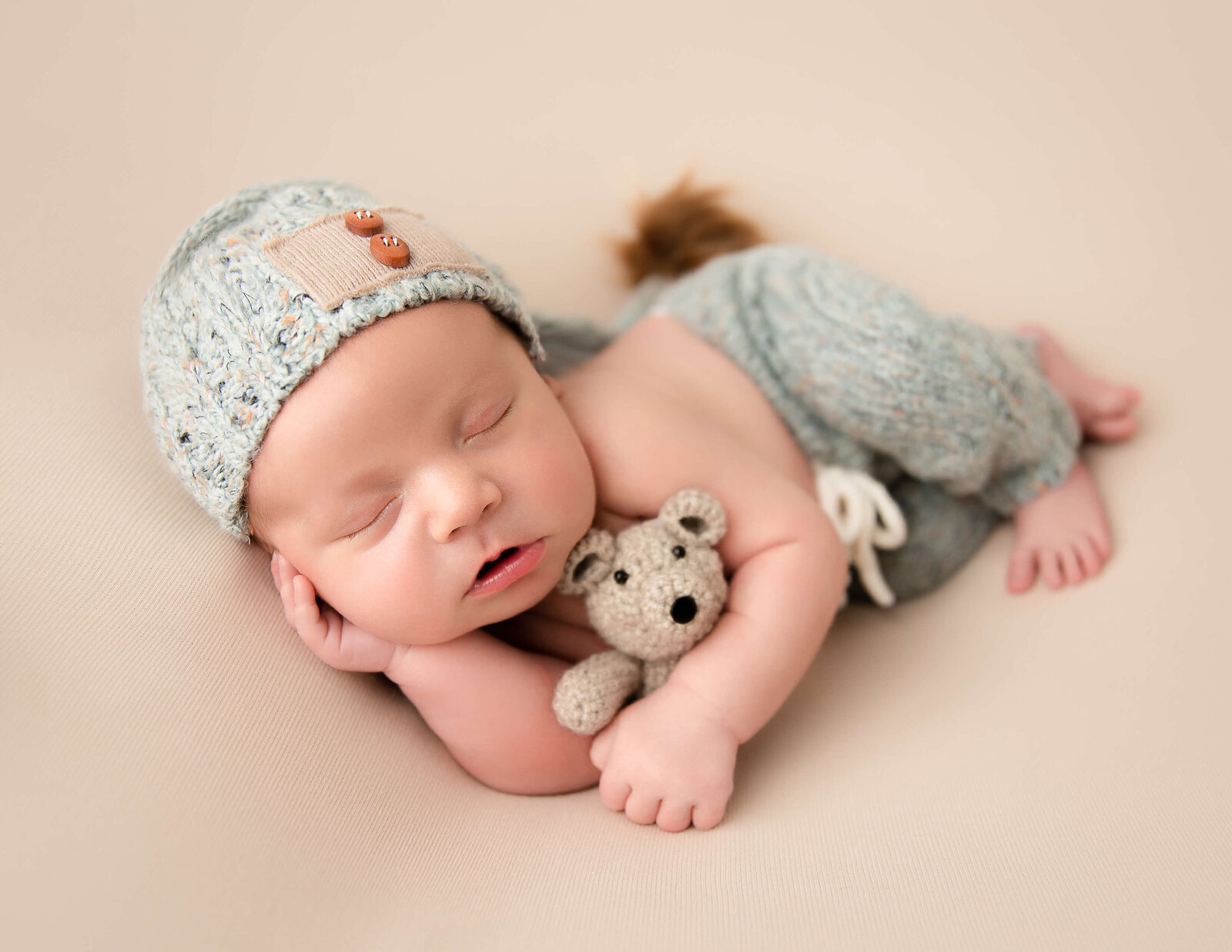 Adorable newborn boy at our studio located in Rochester, NY.