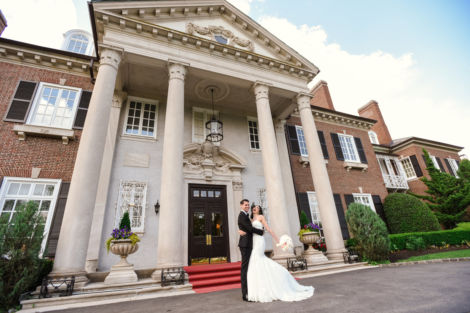 Bride and Groom in front of Glen Cove Mansion