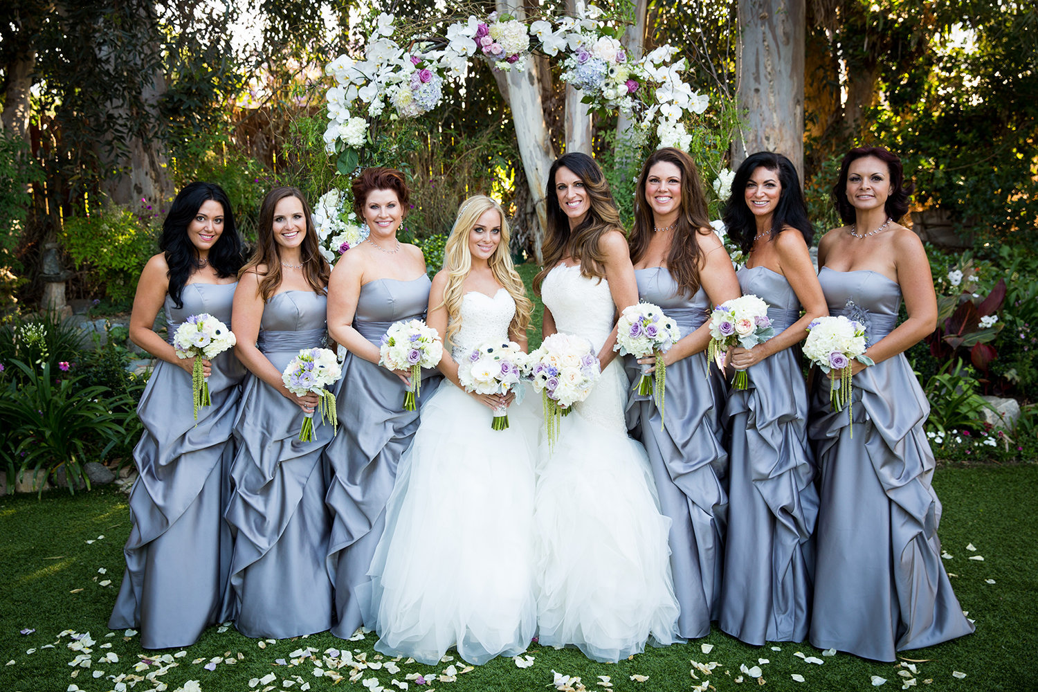 Wedding party along with the beautiful brides at Twin Oaks Garden Estate in San Diego