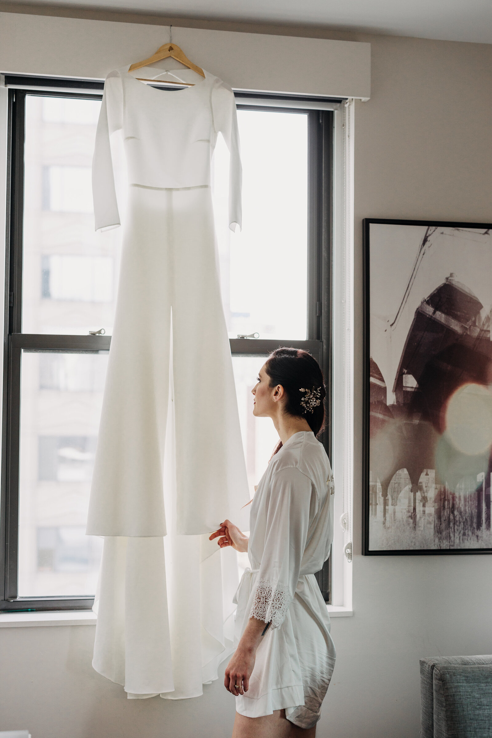 bride looking at wedding modern dress in window