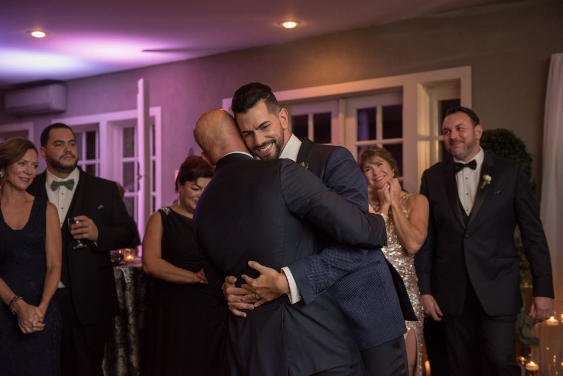 Two grooms' first dance during their wedding at Lord Thompson Manor in CT