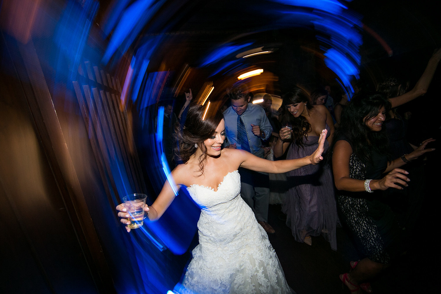 bride dancing with friends at reception