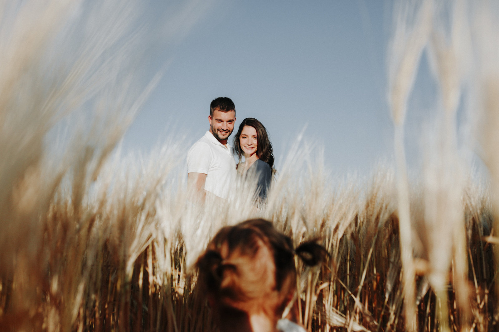 Couples photographer standing in a field in Montana