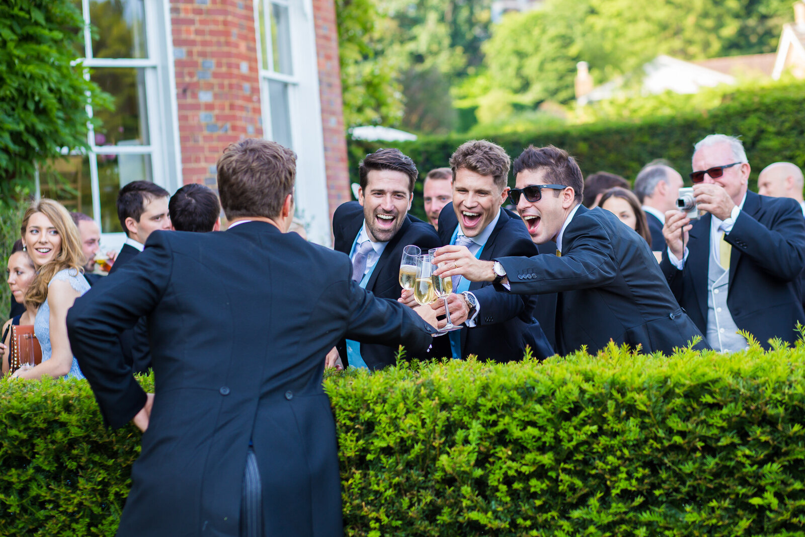 Wedding photography of guests at reception with drinks. Photography by Lynsey Grace Photography