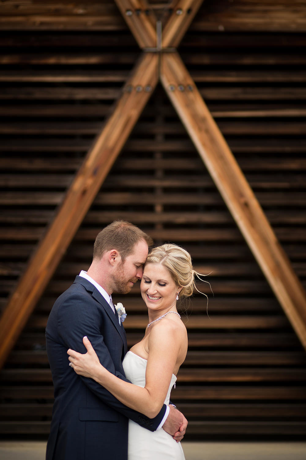 bride and groom with cool wood wall at martin johnson house