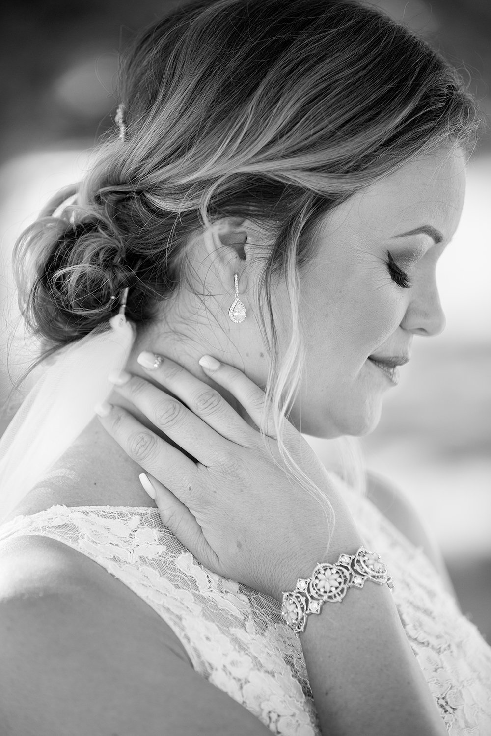 closeup black and white of bride at ocean view room