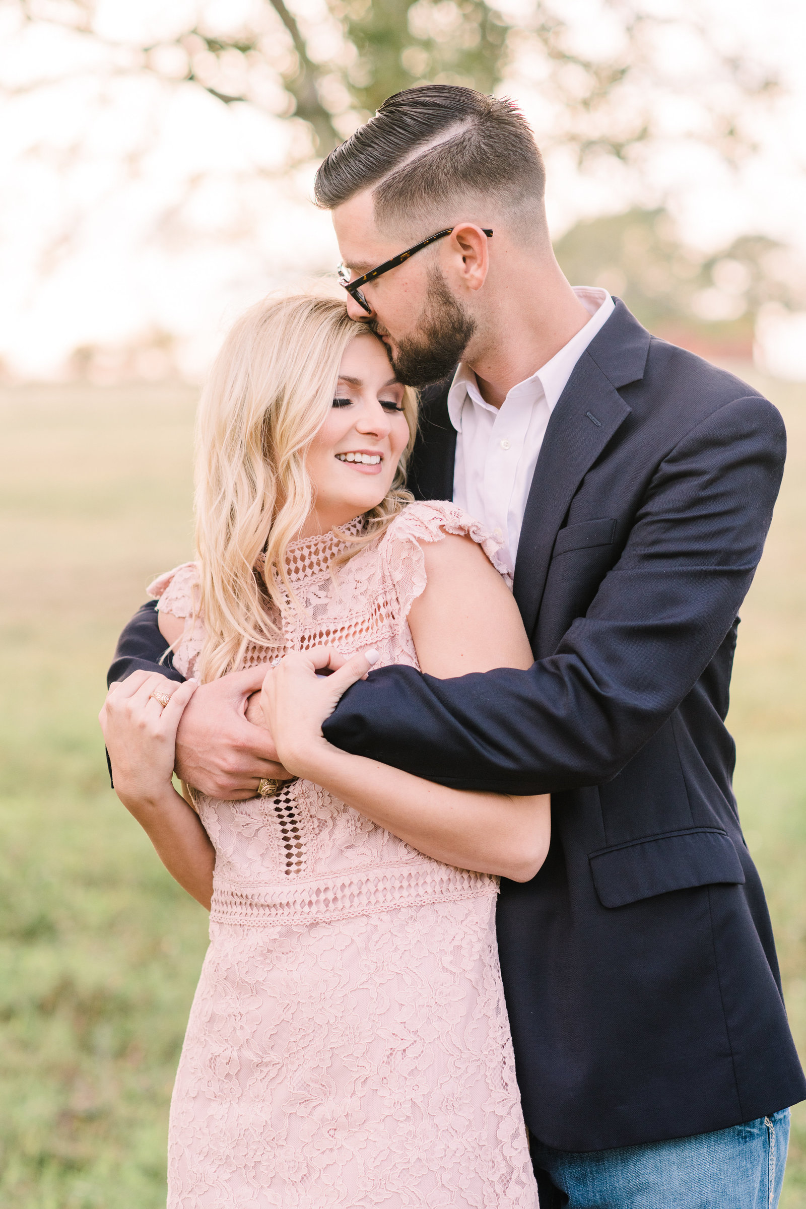engagement portrait of couple in soft pink and navy