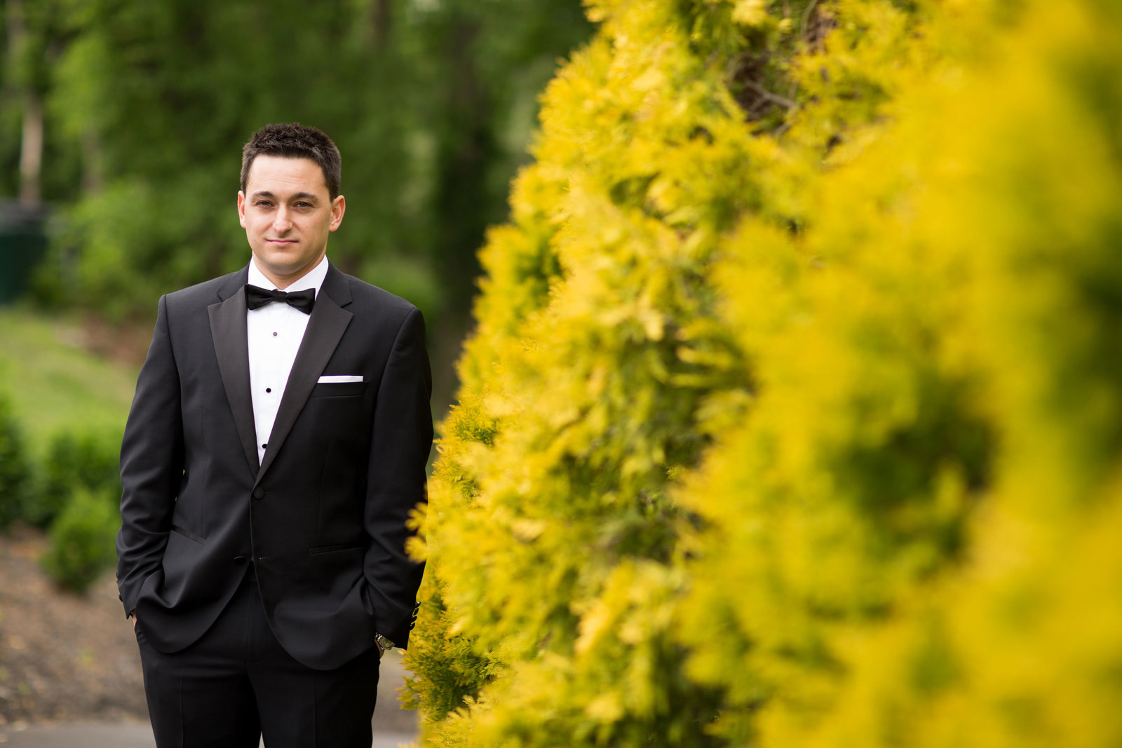 handsome groom waiting for his bride at Engineers Country Club