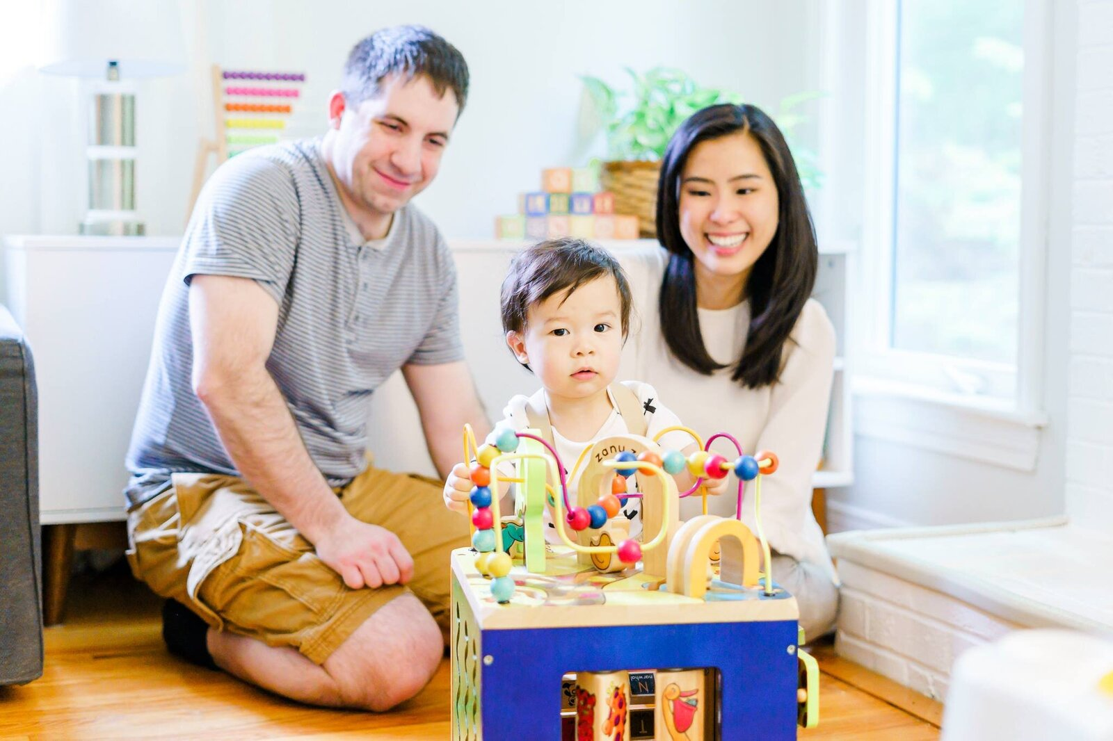 New England area family with baby playing with toys