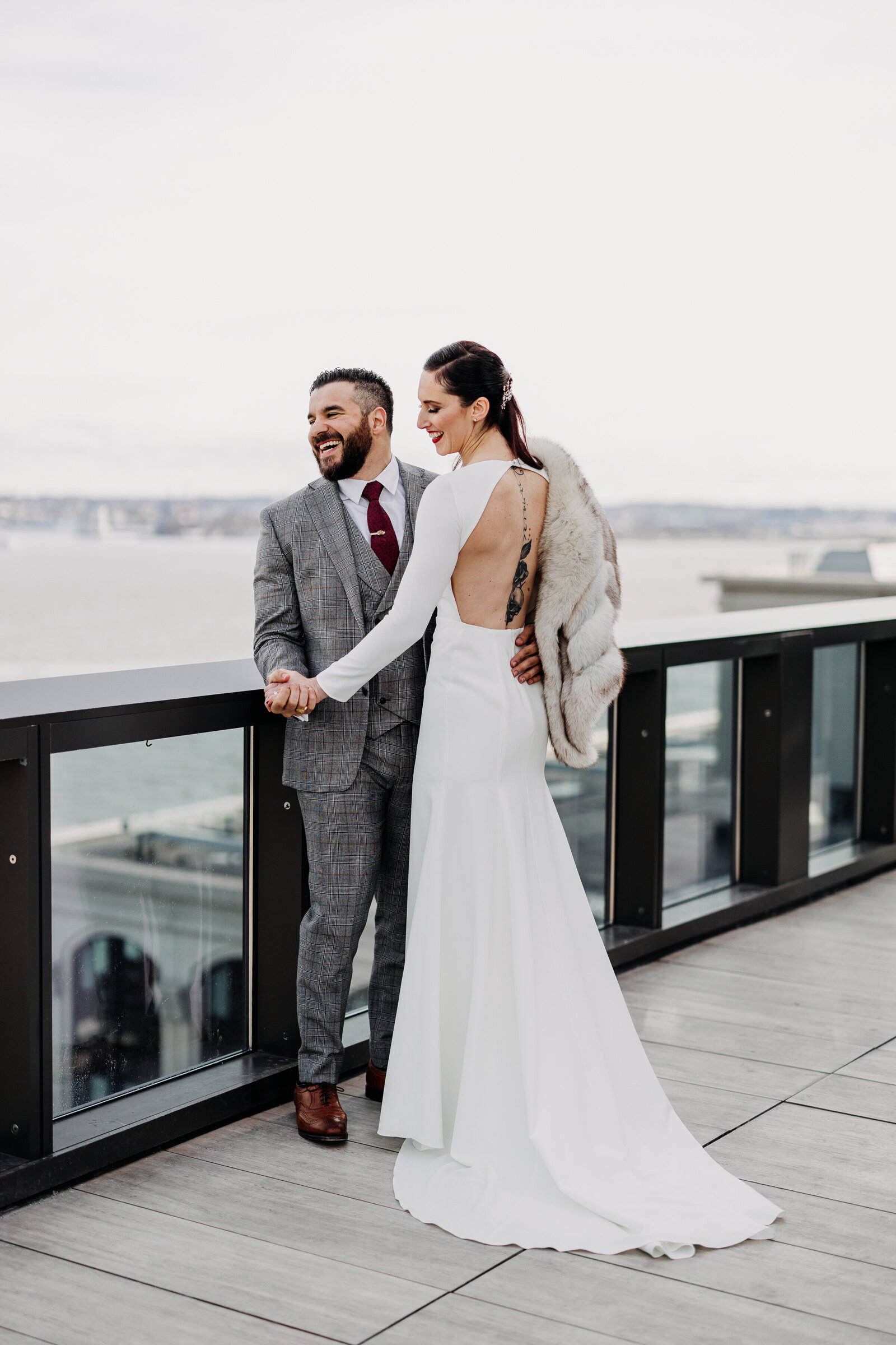 bride and groom at jersey city skyline rooftop