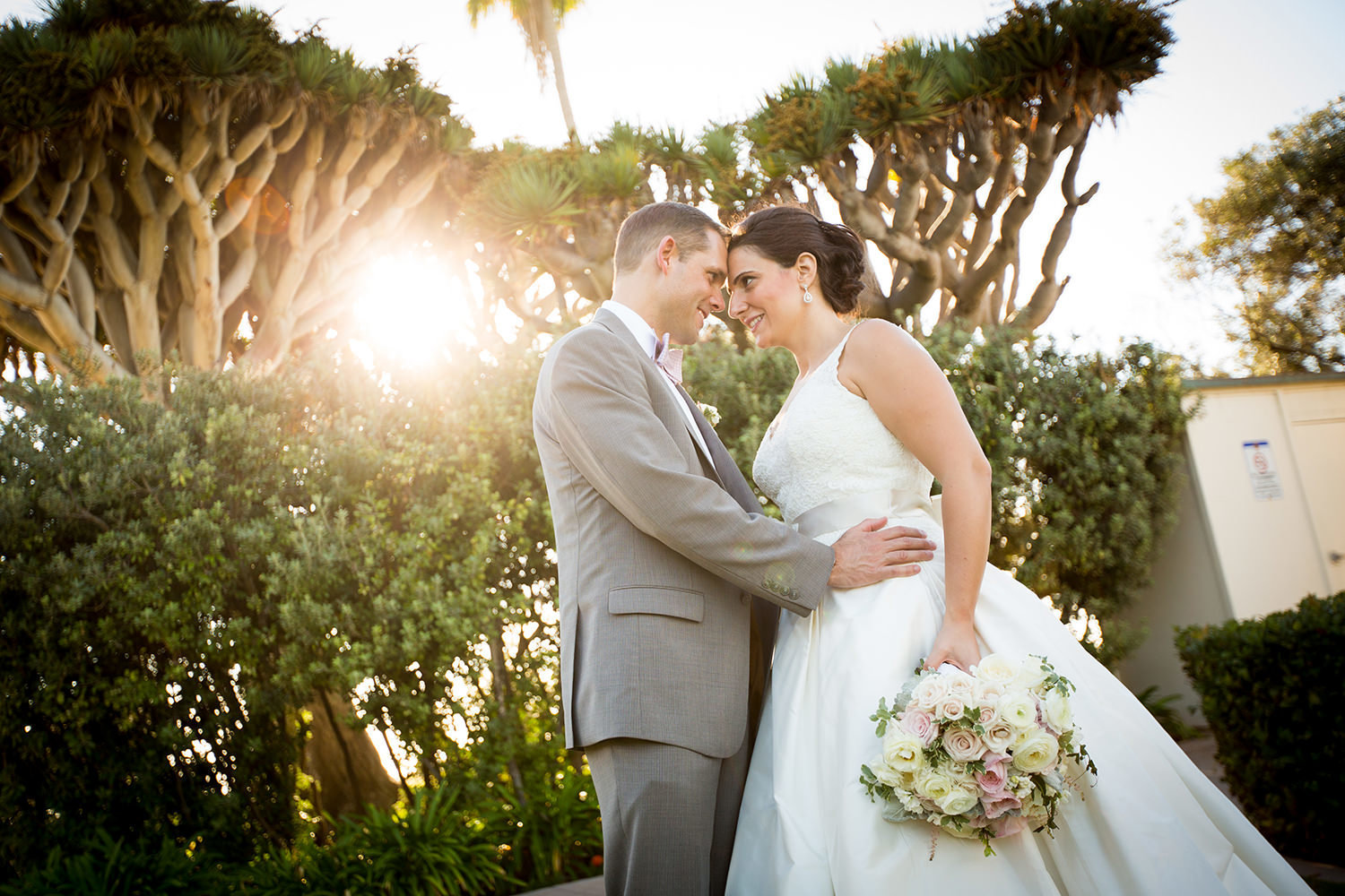 Beautiful sun flare for this wedding portrait