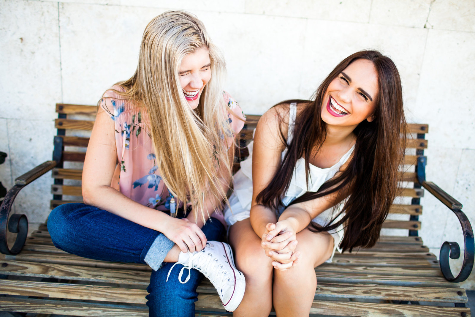 Girls laughing on a bench in Winter Park Florida