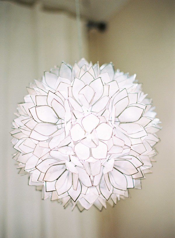 An abstract white petaled lighting fixture.