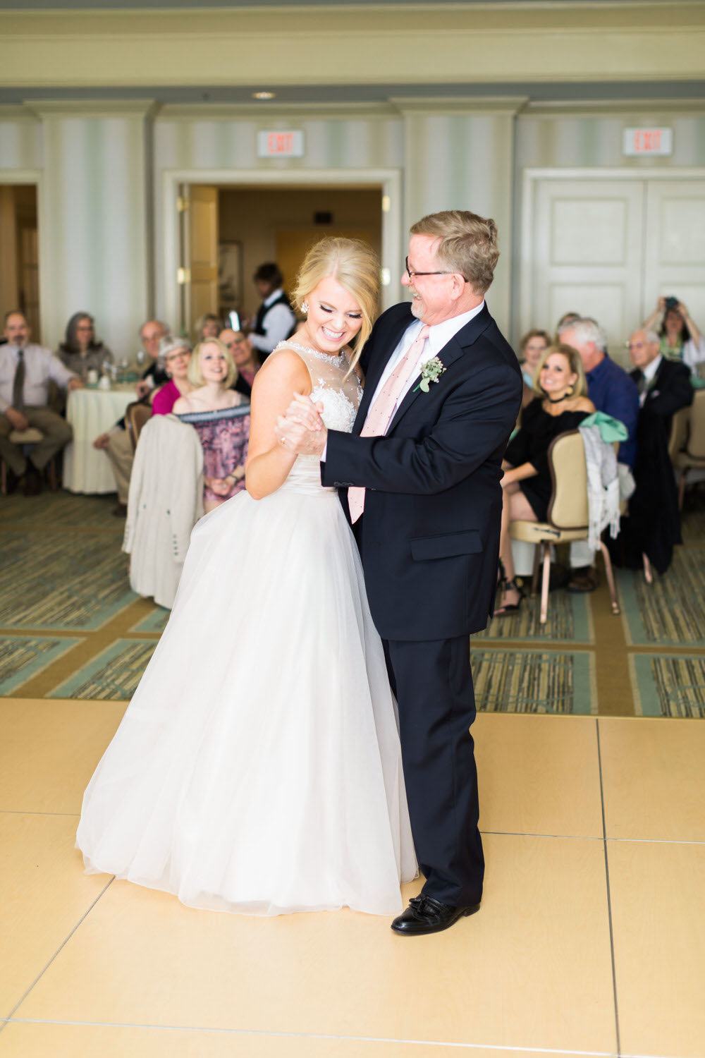 bride dancing with dad at reception