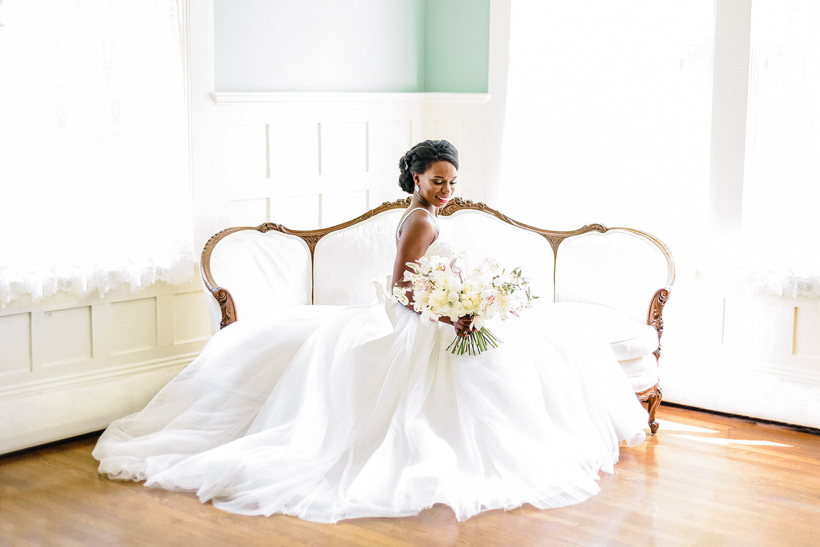 black bride posing on couch