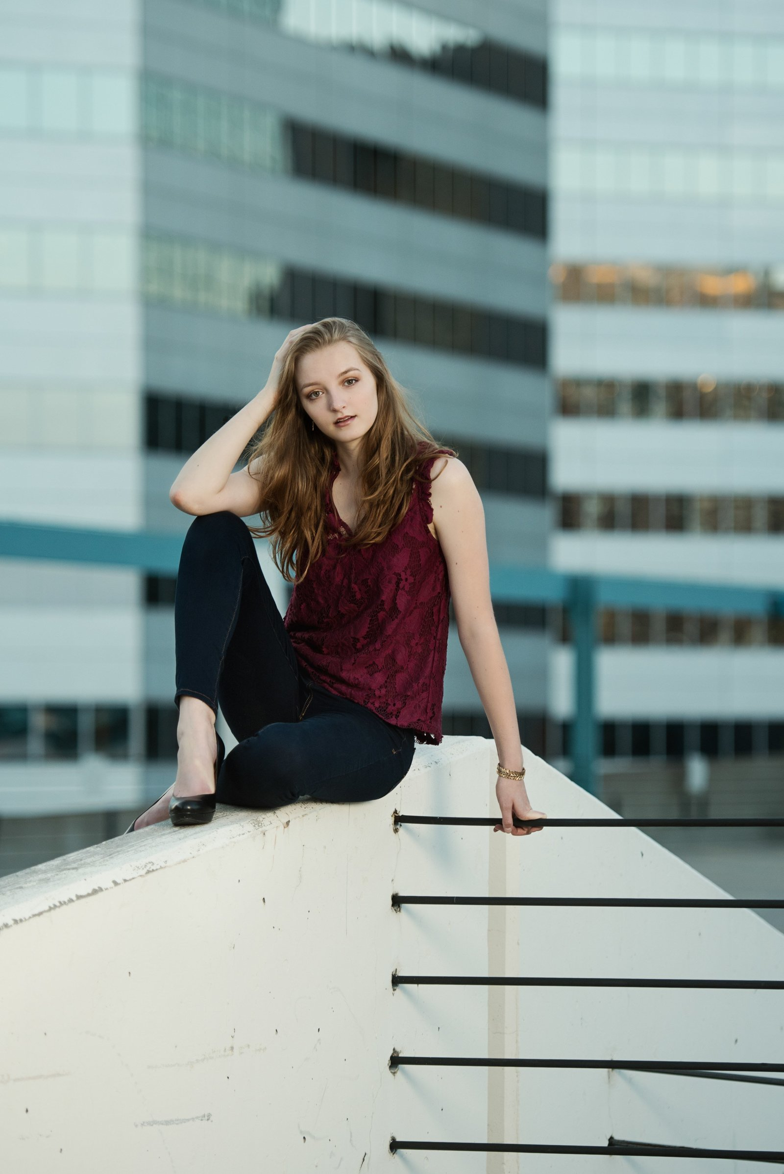 Senior picture of girl with cityscape behind her