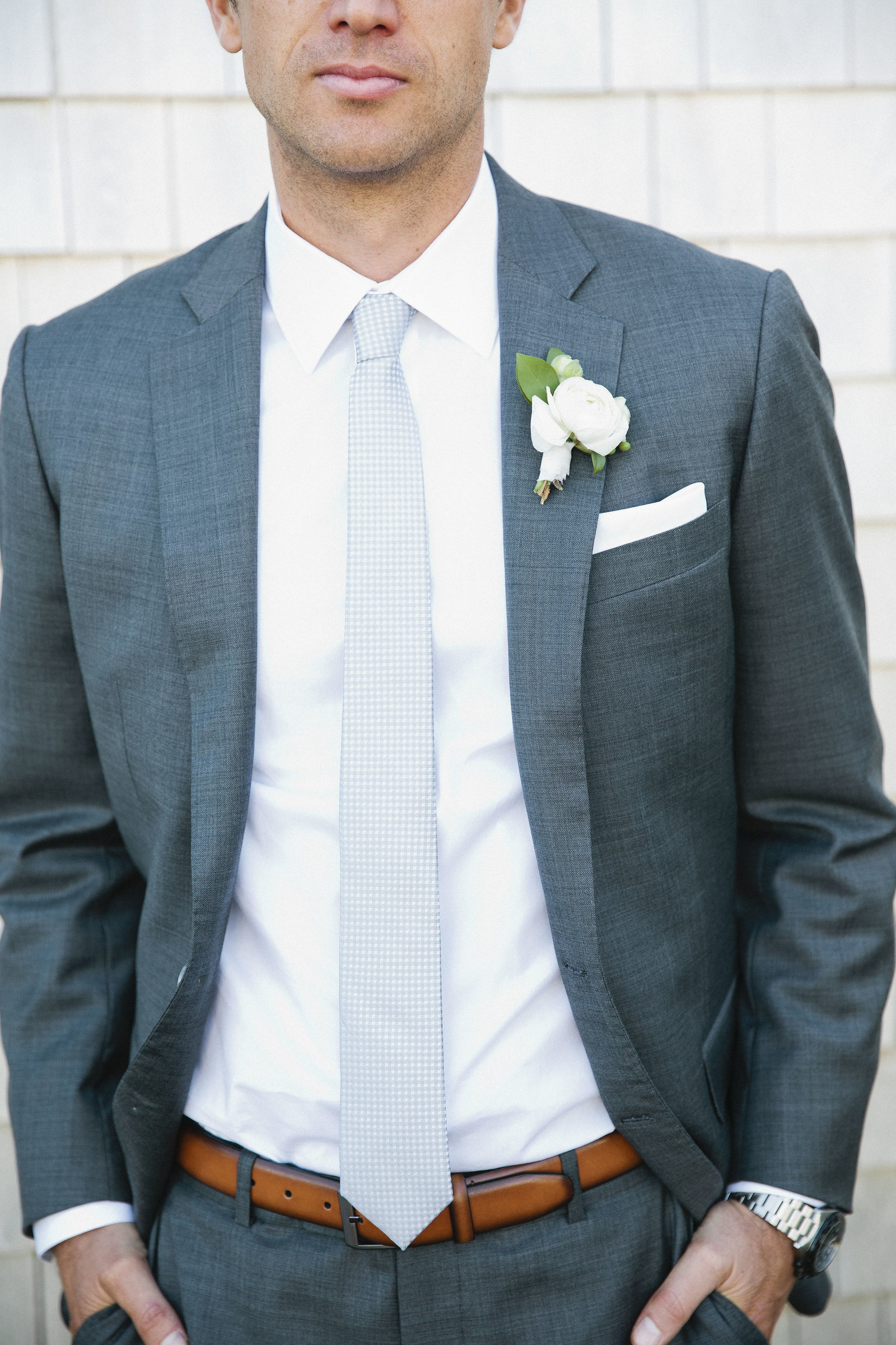 Gray custom suit and white boutonniere for groom on Cape Cod