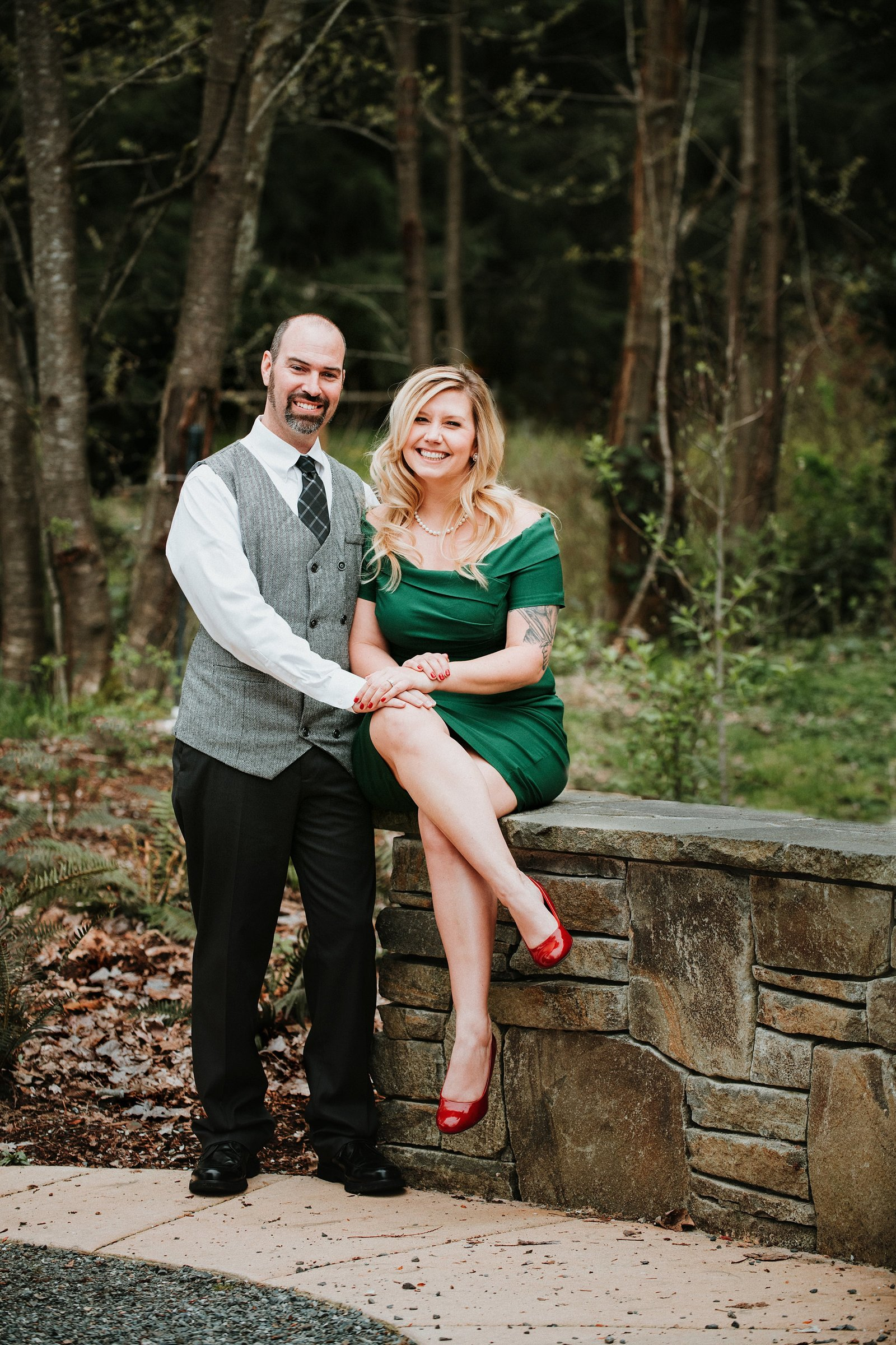 Woman sitting on brick wall with fiancee by Roslyn Engagement Photographer