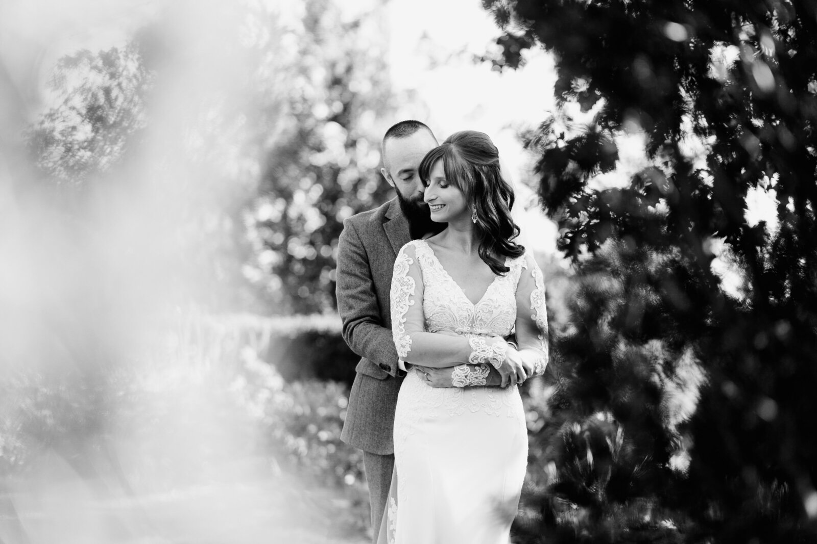 black and white couple hugging nature