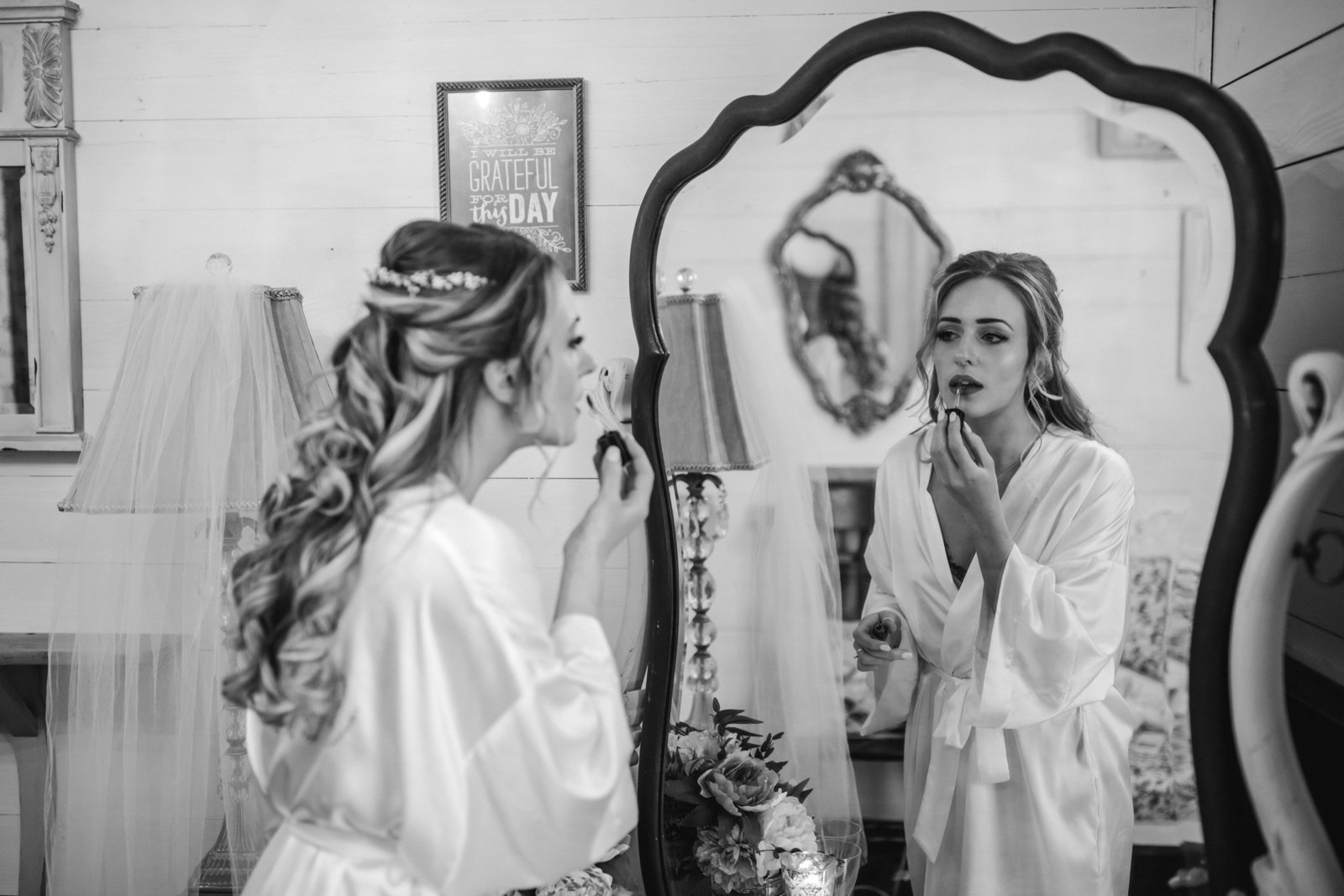 Finishing touches are not complete until the bride touches up her lipstick on last time before getting in her dress at Apple Ridge Farm