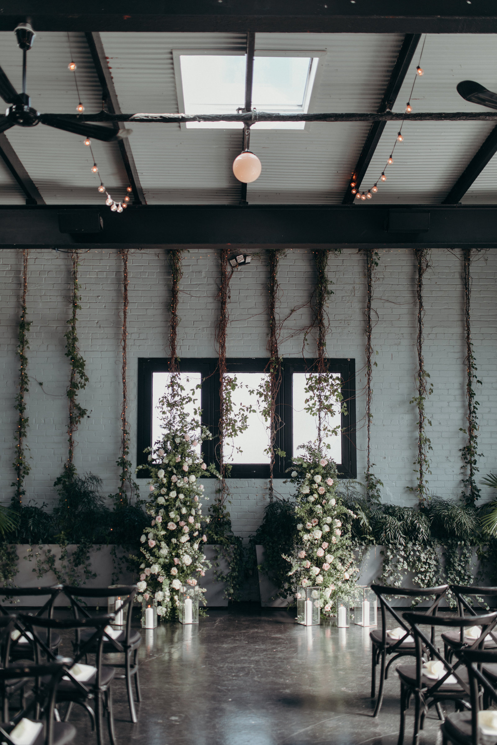 New York City 501 Union wedding flower columns flank the happy couple in this beautiful and classy vibe ceremony