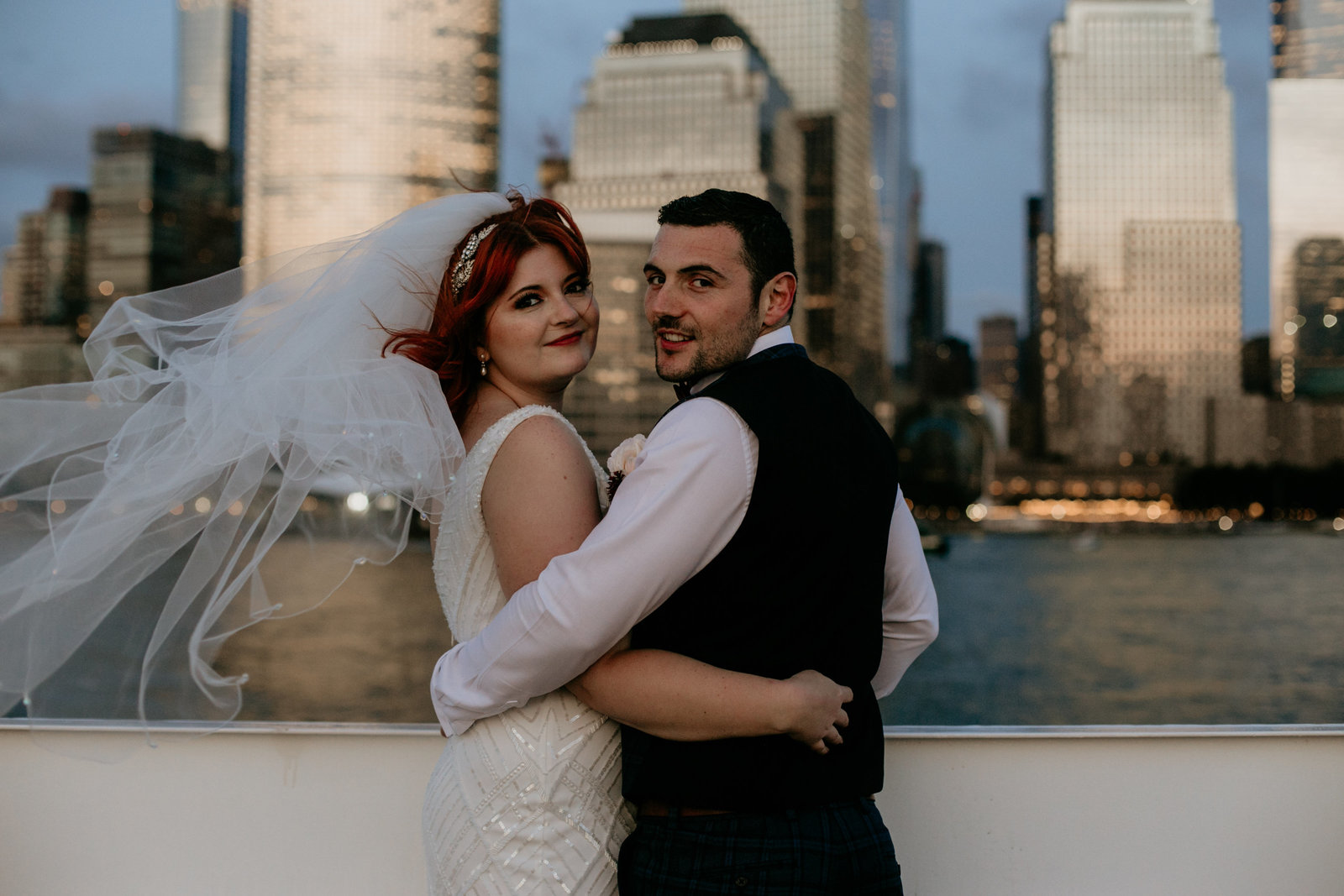 bride and groom on a boat in nyc