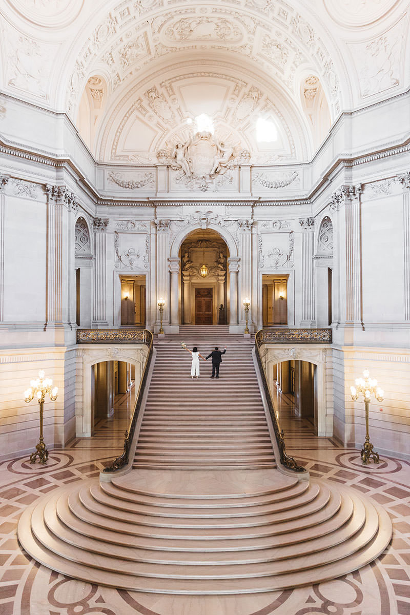 early morning grand staircase wedding couple epic wide shot