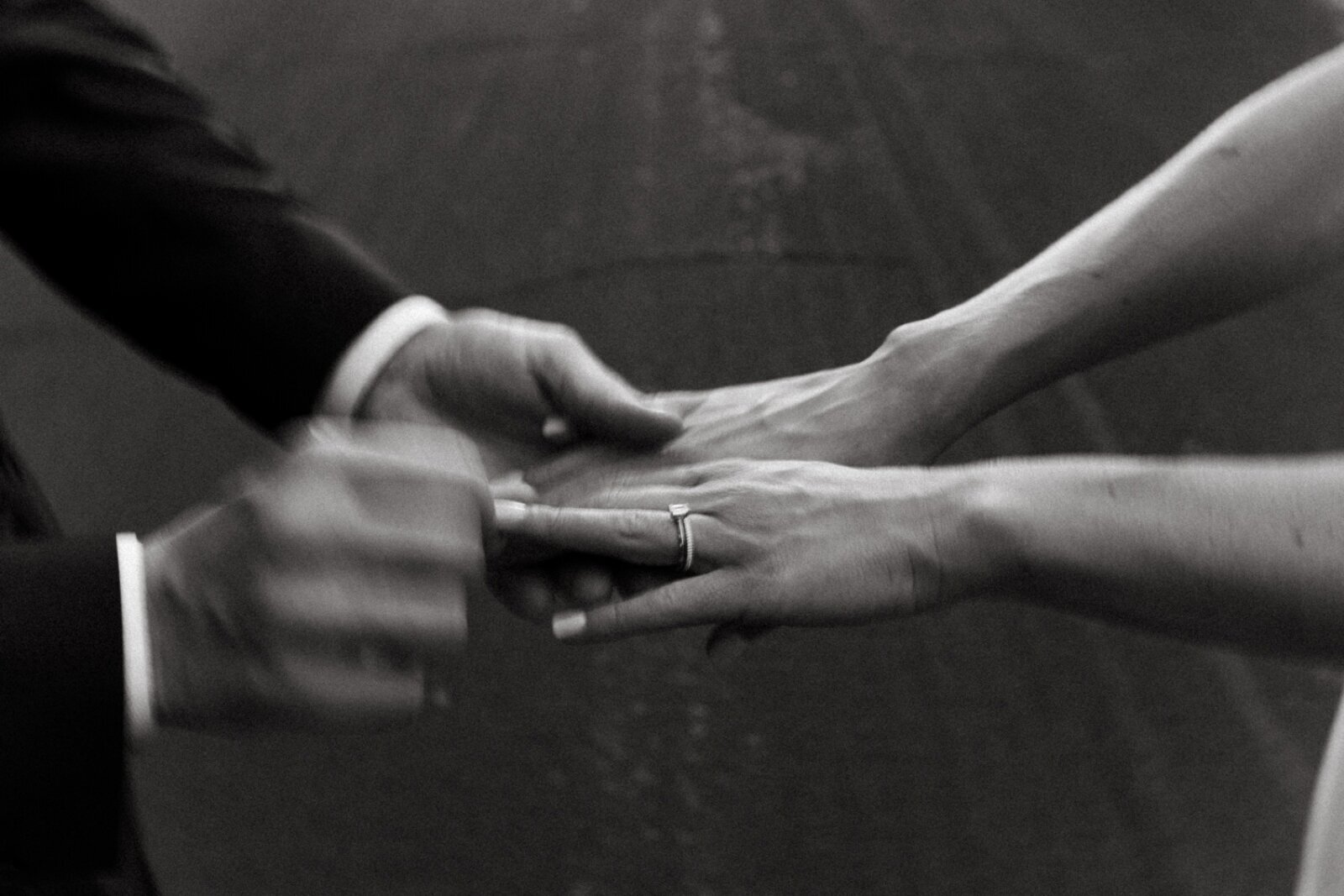 black and white bride and groom hands