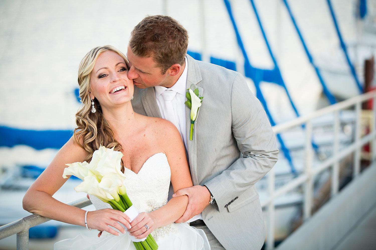 bride laughing with dock in background