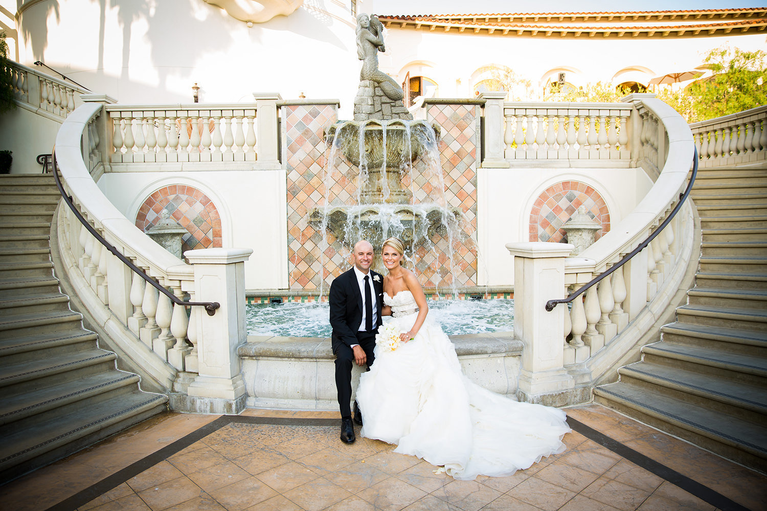 The water fountain between the staircases sets the perfect scene for this romantic portrait