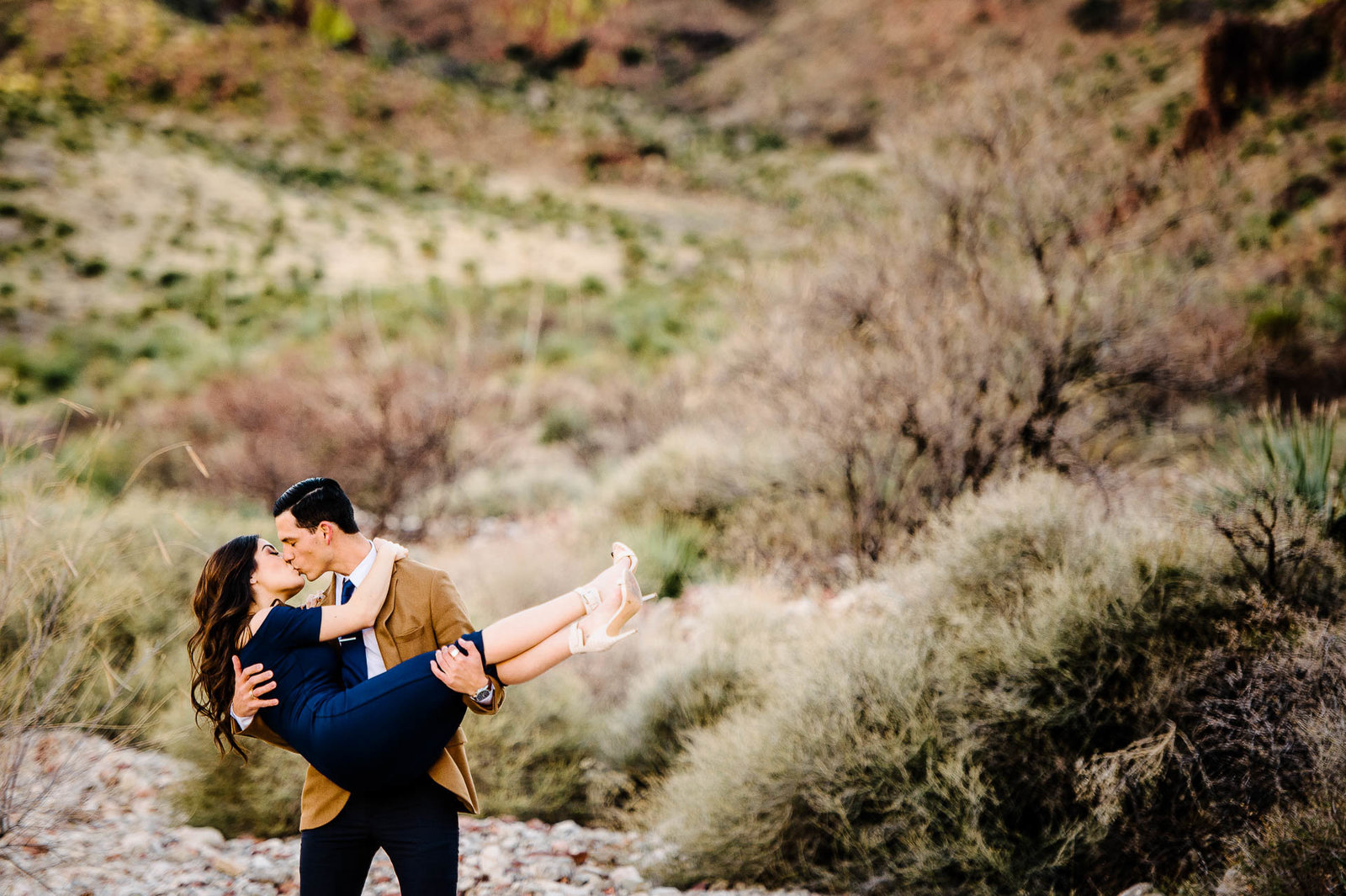 Couple kissing during a desert chic engagement session in el paso texas