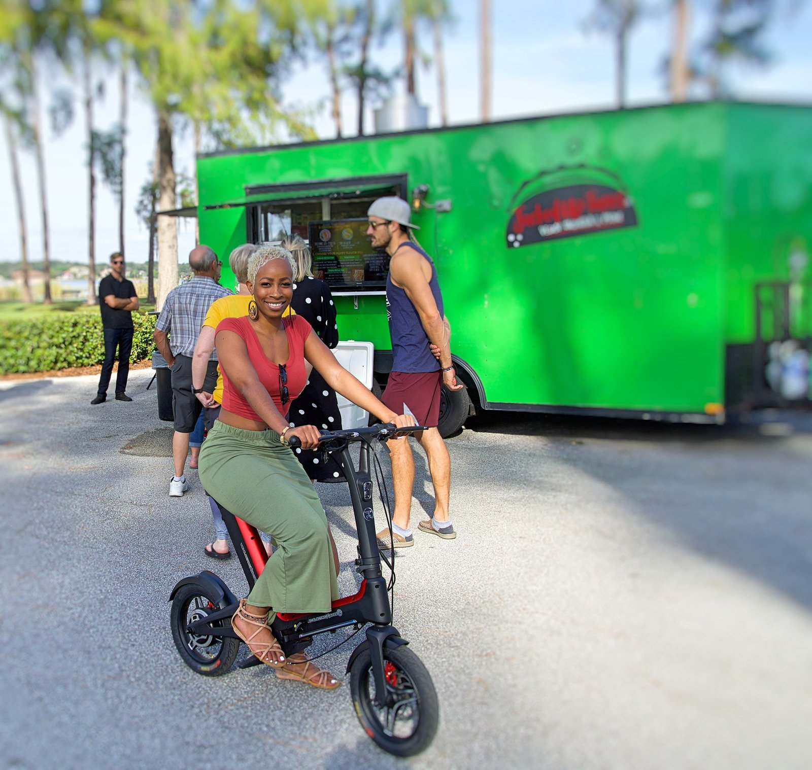 Red Go-Bike M3 with green food truck