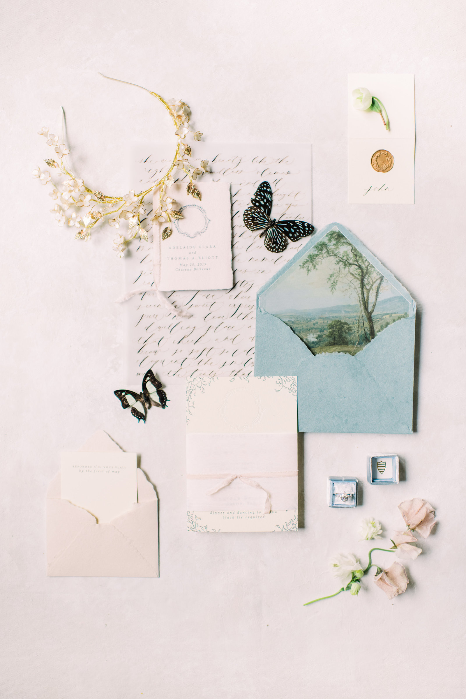 soft blue wedding invitation suite styled with butterflies
