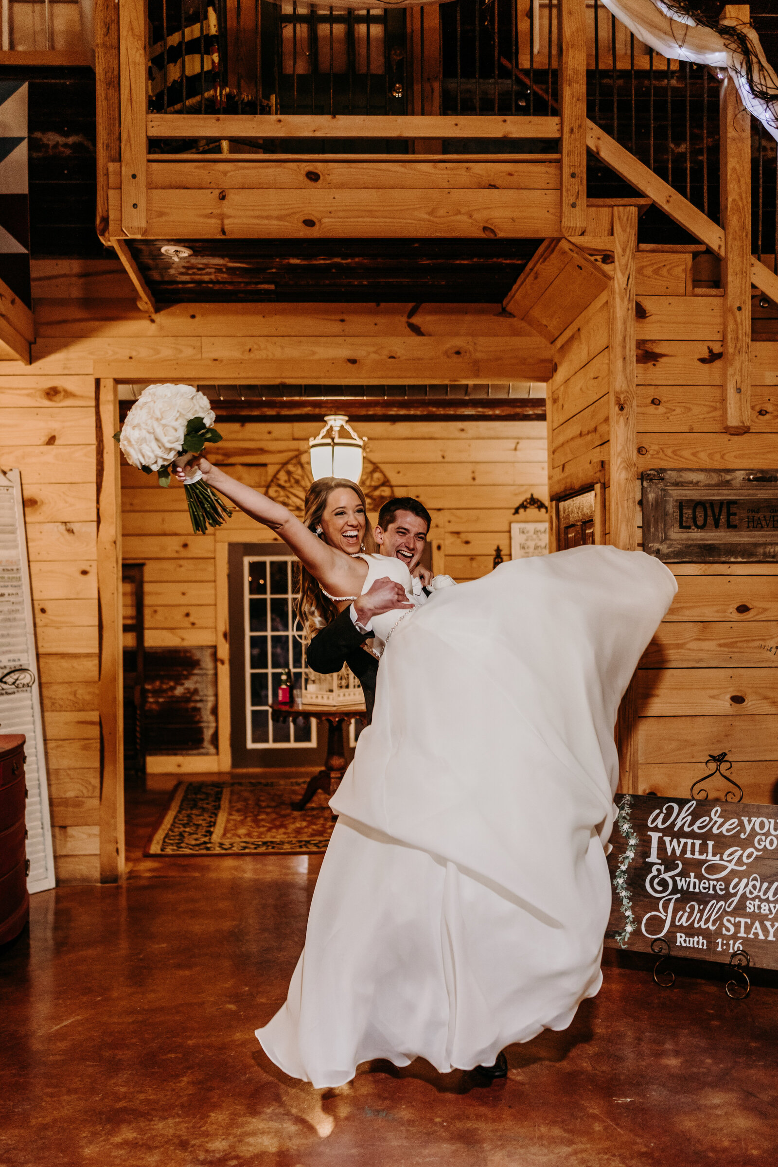 J.Michelle Photography photographs bride and groom entering the reception at vintage oaks farm wedding in Athens, Ga
