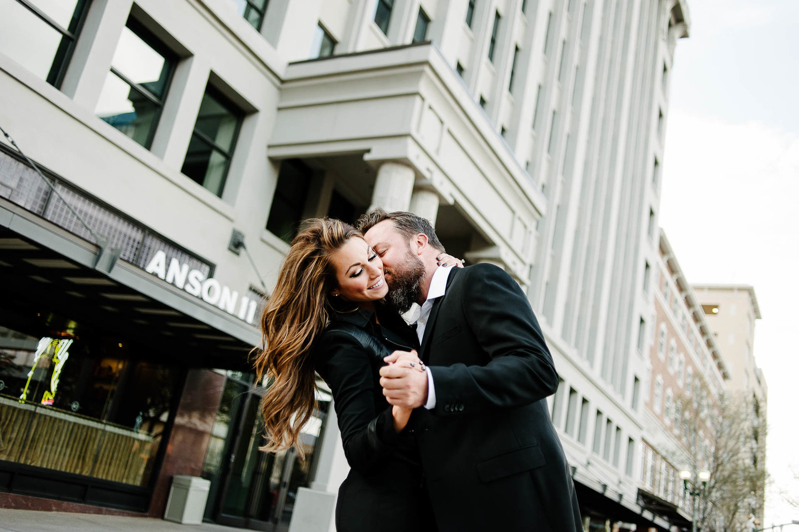 couple dancing in downtown el paso during their el paso engagement session