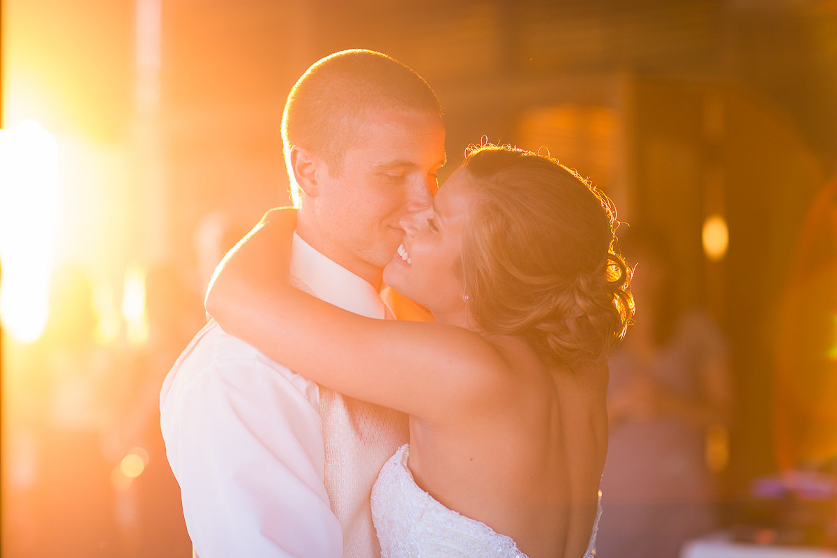 sunset image of couple by a husband and wife at a wedding