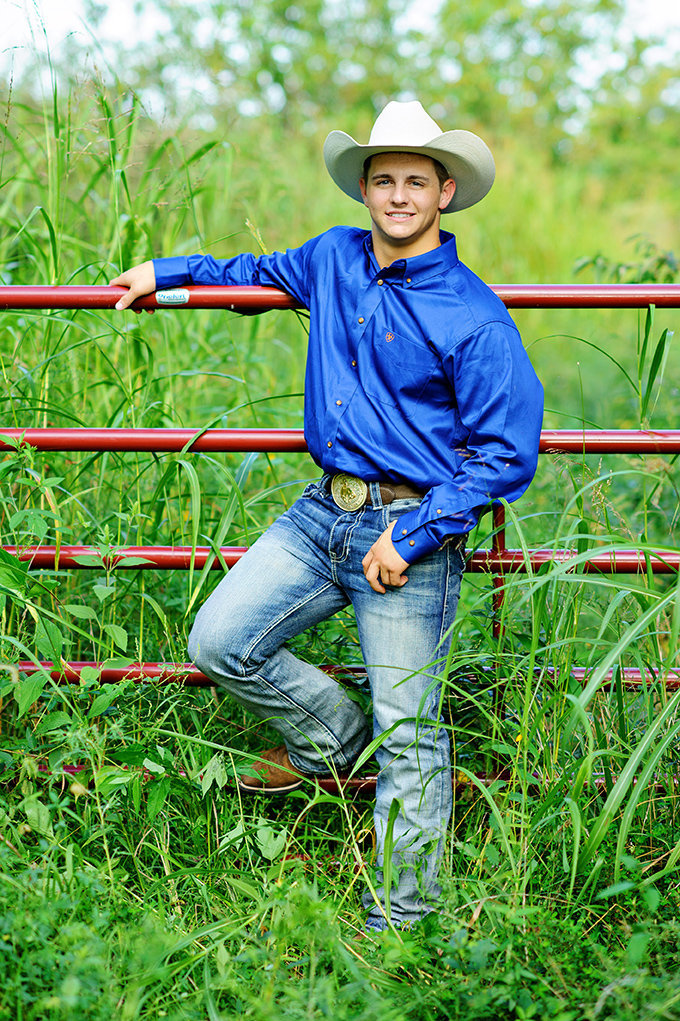 country senior pictures cowboy fence