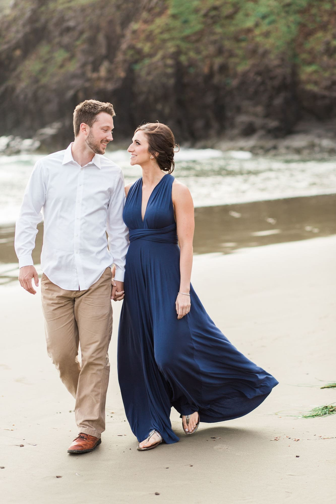 Wind blows dress during engagement session at Ecola State Park