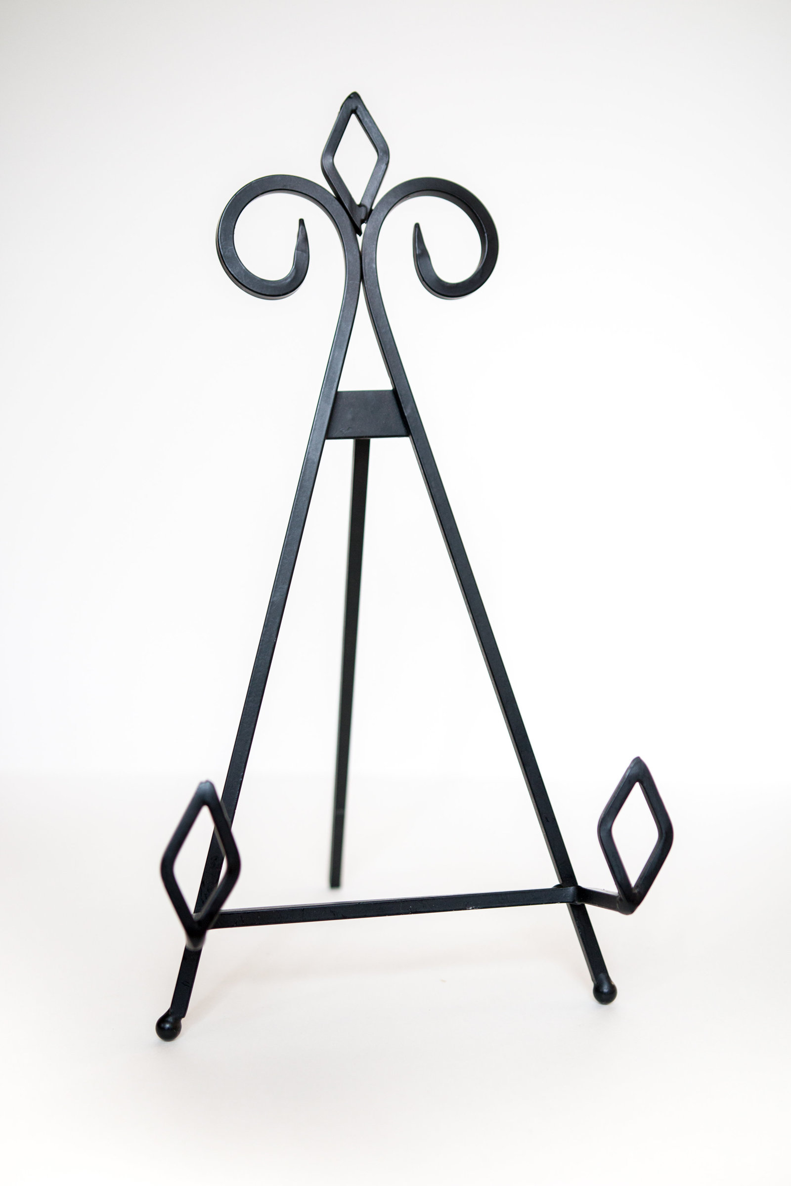 Matte black metal table easel for events or weddings through Hue + FA Rental