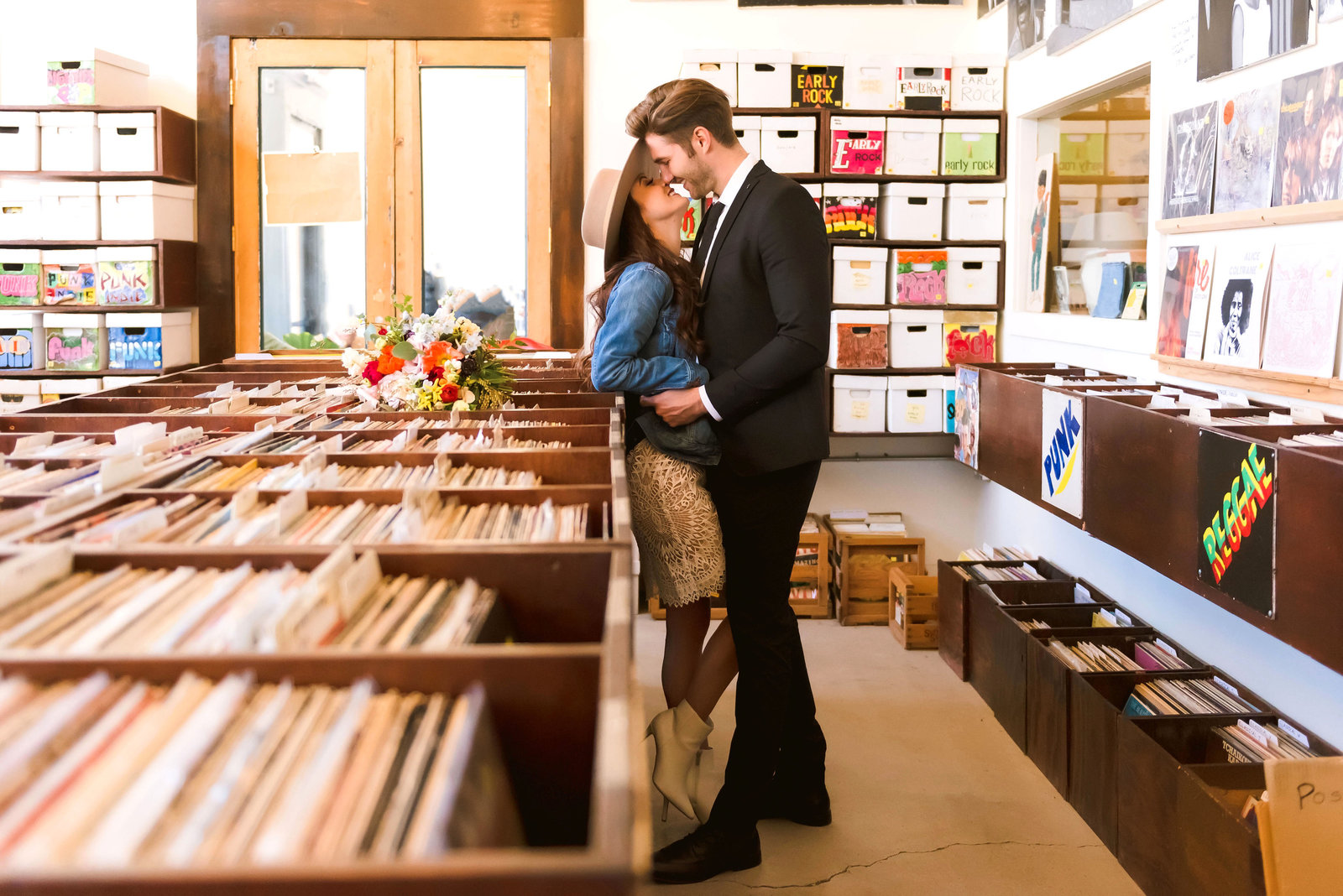 Detroit engagement photos of a bride and groom in a record store | Erin Schmidt Photography