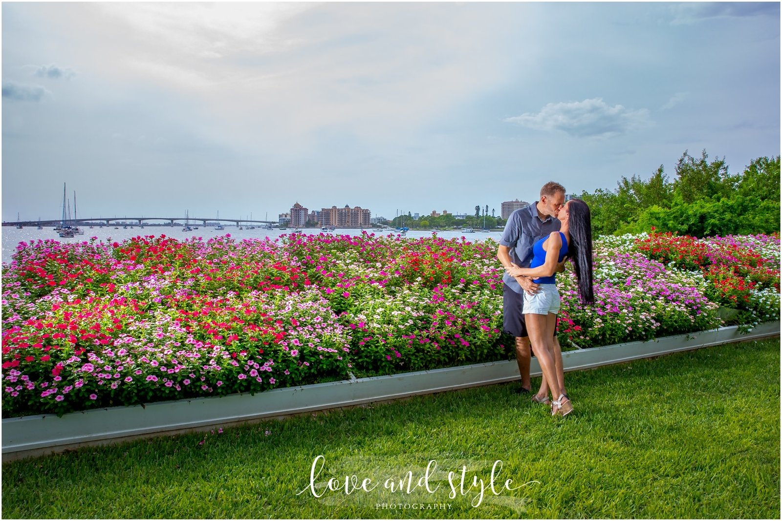 Engagement Photography at Selby Gardens in front of the flower beds with couple embracing and kissing
