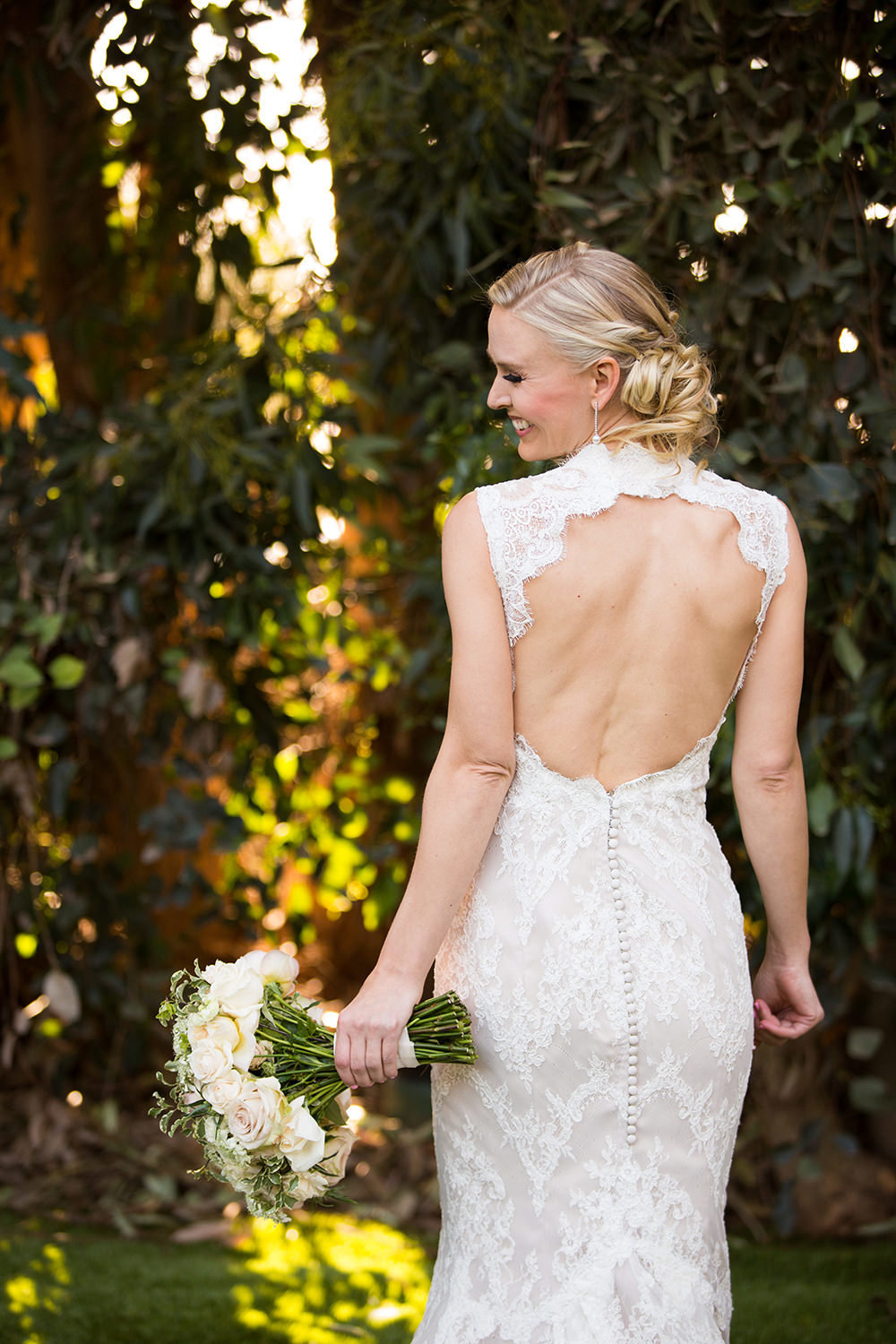 Incredible back of the dress portrait of beautiful bride